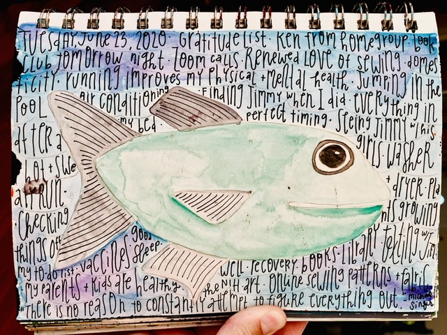 Watercolor painting of fish in water. Gratitude list written on top.