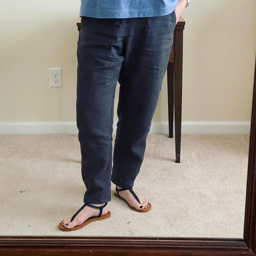 Photo of lower half of woman modeling grey linen pants.